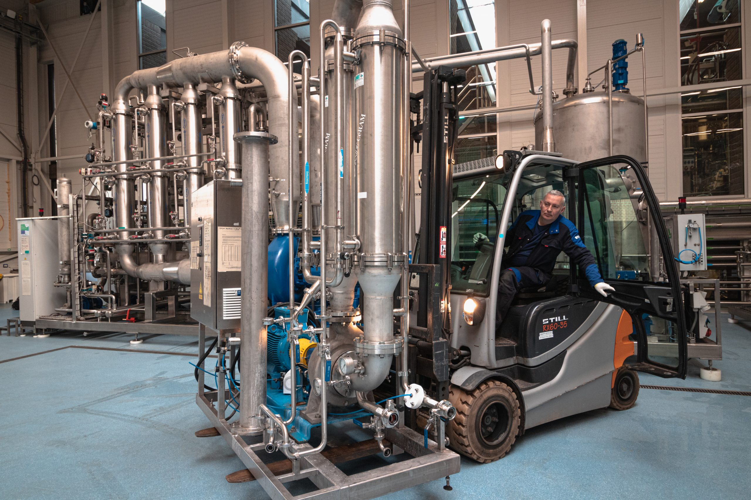Picture: A technician is moving a ceramic filtration unit using a forklift at the Bio Base Europe Pilot Plant